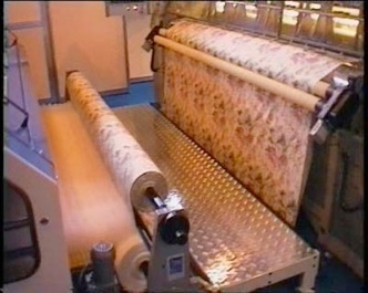 Nowo polyester machine connected to TEC multineedle quilter